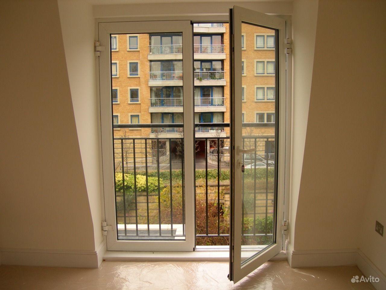 Двустворчатые распашные балконные двери..